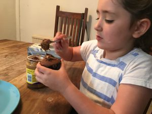 Decorating cupcakes with chocolate