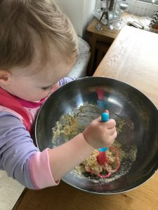 Erin mixing the cake batter - baking with a toddler