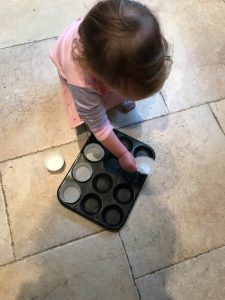 Putting the paper cases in the tin - baking with a toddler