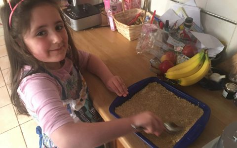 Eve making flapjacks