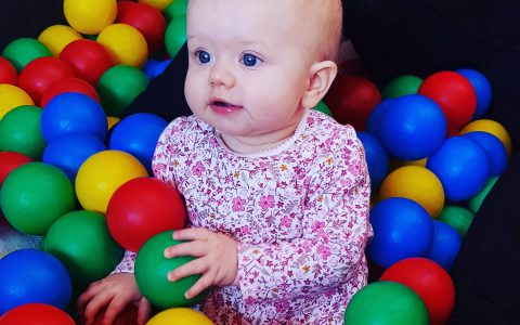 Little Girl in Ball Pool