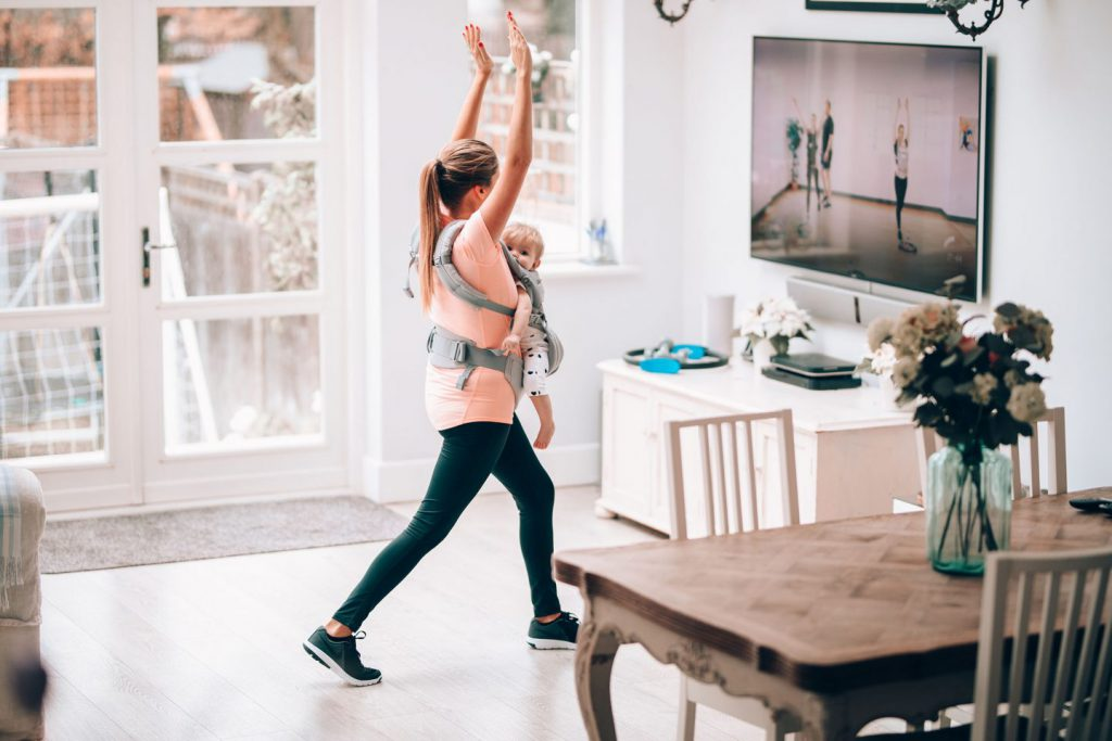 Mum working out with child in carrier