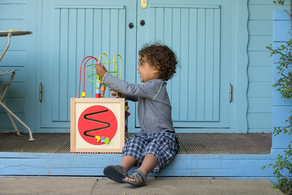 Child with hippychick toy box