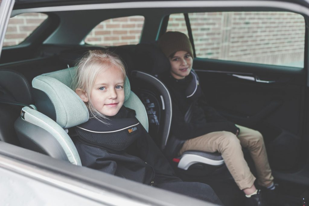 children in booster seats in a car