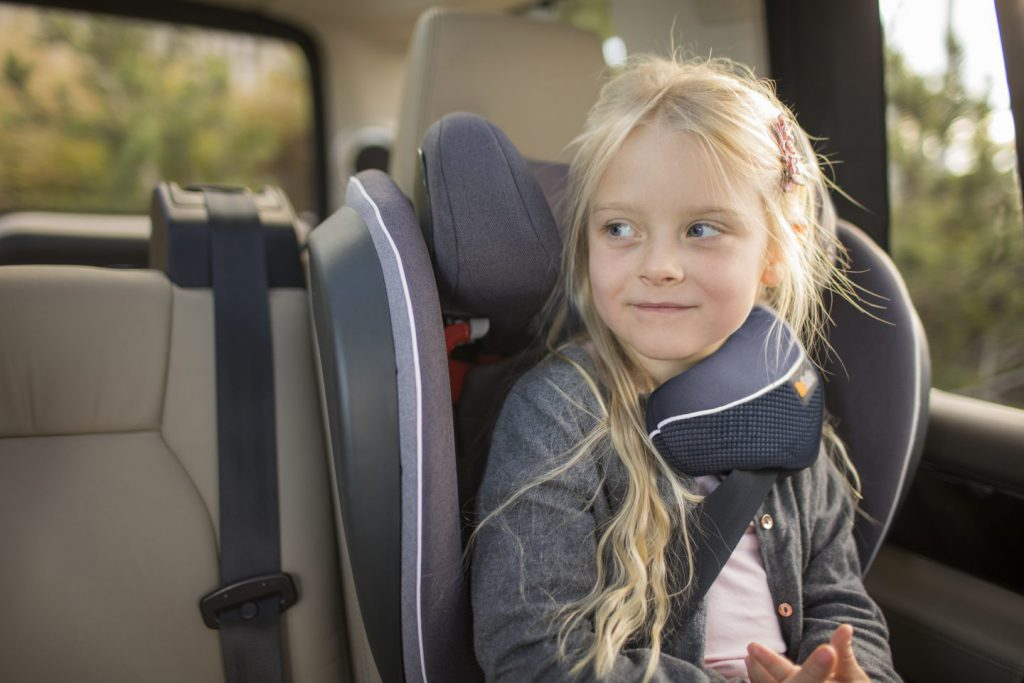 Girl in BeSafe booster seat