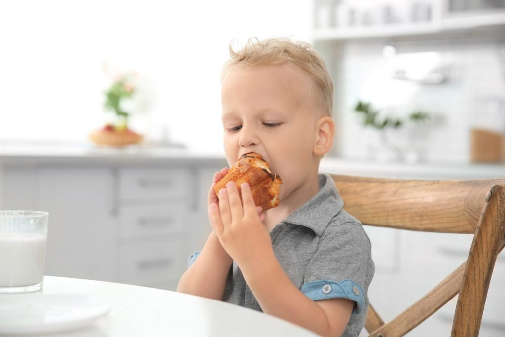 Boy eating muffin